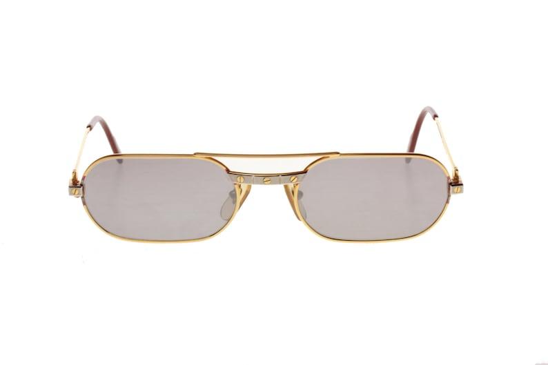 54bc20b4eb Cartier Must Santos golden sunglasses with silver santos