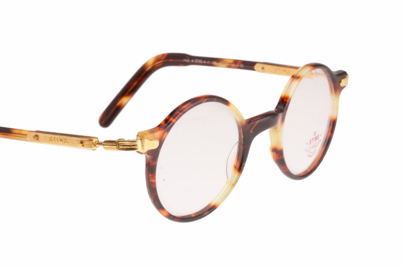 091084991c Sting classic round retro eyeglasses frames in tortoise cello