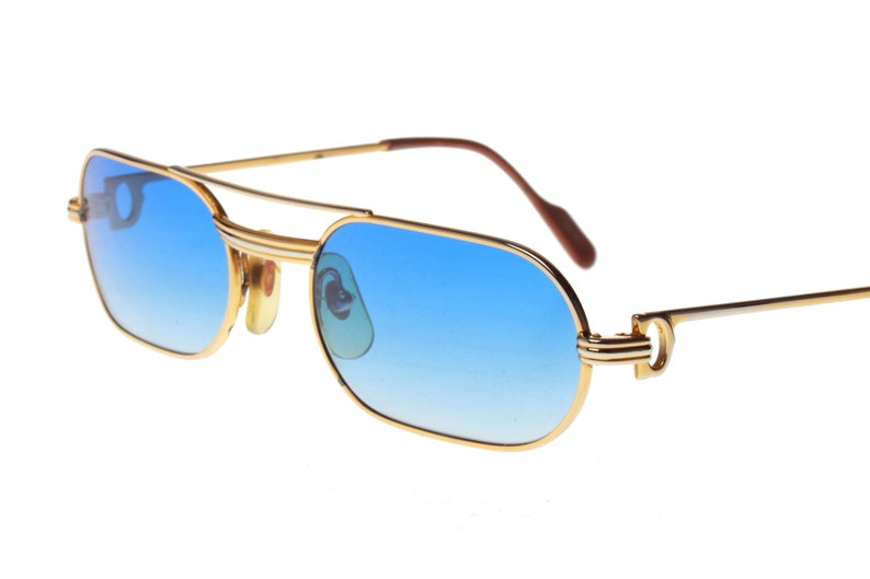 9812bbd8fb Cartier Must Louis C decor golden sunglasses with blue fade