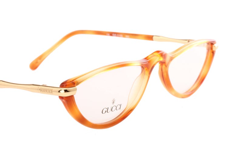 46578df05b Gucci vintage half moon golden metal honey cello reading