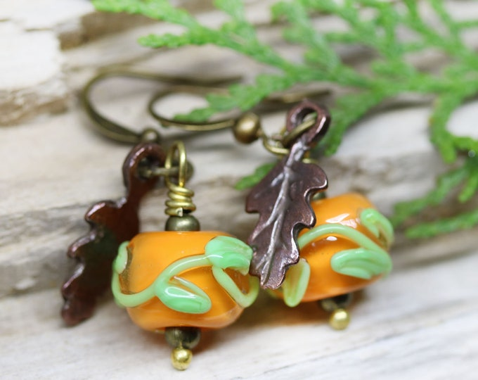 Orange lampwork glass beaded earrings with leaf ornament, Copper leaf charm dangle earrings by MayaHoney