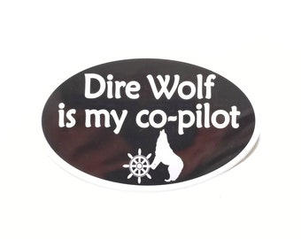 """Dire Wolf is my co-pilot Bumper Sticker - Black with white text, Oval-Shaped, 5"""" x 3"""""""