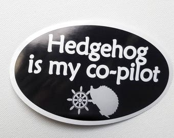 """Hedgehog is my co-pilot Bumper Sticker - Black with white text, Oval-Shaped, 5"""" x 3"""""""