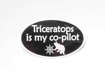 """Triceratops is my co-pilot Bumper Sticker - Black with white text, Oval-Shaped, 5"""" x 3"""""""