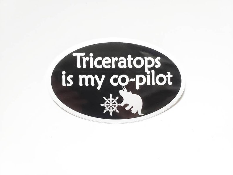 Triceratops is my co-pilot Bumper Sticker  Black with white image 0