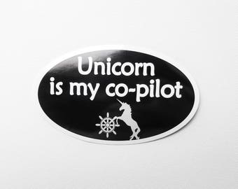 """Unicorn is my co-pilot Bumper Sticker - Black with white text, Oval-Shaped, 5"""" x 3"""""""