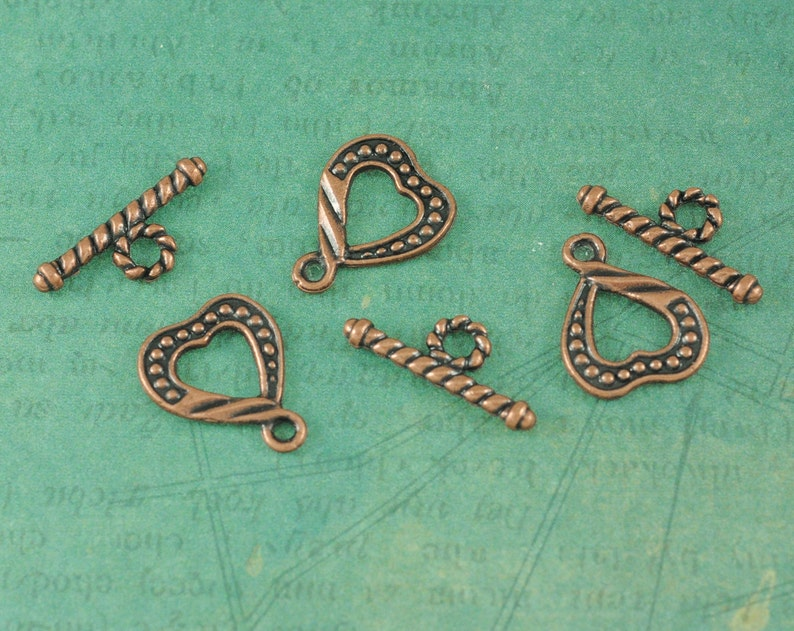 Measures 58 Package of 6 Sets Twisted Heart Antique Copper Toggles