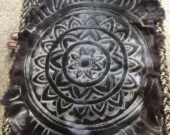 Handcarved mandala design goat hide