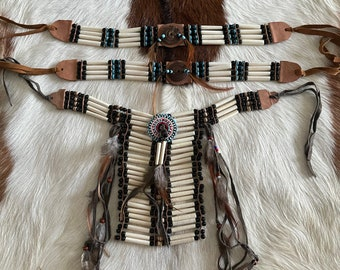 Bone tribe neck and arm bands.