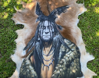 Hand painted goat skin.