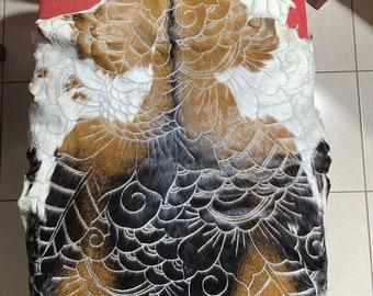 Hand carved goatskin.