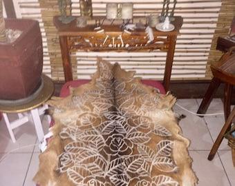 Rose design. Handcarved goat skin.