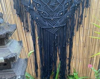 Black macrame wall hanger 100 cm across. 150 cm long.