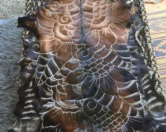 Hand carved goatskins