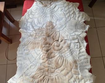 Cream / fawn goatskin. Handcarved