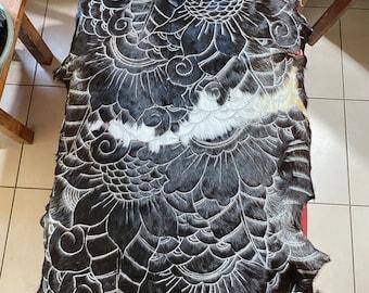 Hand carved goatskin rug.  Black and white.