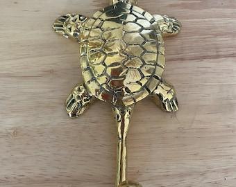Brass turtle hook.