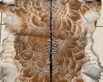 Hand carved goat skin.