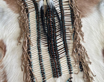 Handcarved bone and suede Indian chest piece.
