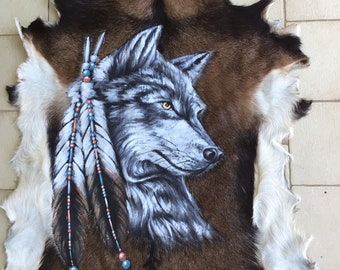 Wolf design.  Hand painted goat hide.