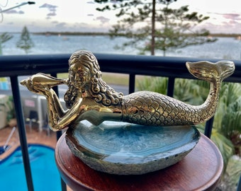 Brass mermaid. Holding a shell
