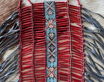 Red bone chest piece.                             30 cm wide. 50 cm long.                         Handcarved bone