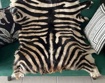 Zebra print handpainted goathide.