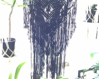 Black macrame wall features.