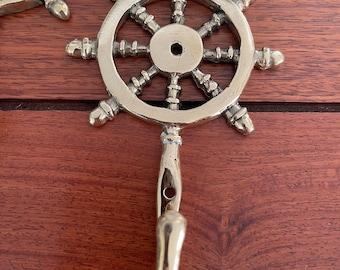 Captains wheel brass hooks.