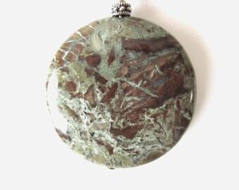 Snakeskin jasper pendant on leather necklace