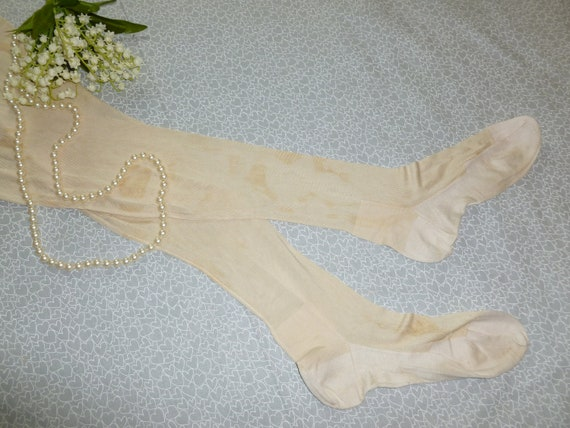 NOS Antique pair of Garter Stockings Off White Sea