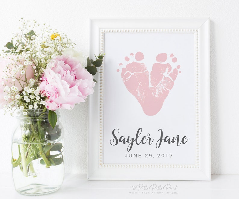 """You want to give a fathers day present on behalf of your baby? - That's an unusual idea, but we love it. Here is an ideal gift for a first-time Dad from his baby - A Baby Footprint & Handprint Art. This will be the baby's """"first step"""" into his Father's life and he'll be completely speechless when he receives such a meaningful father's day present."""