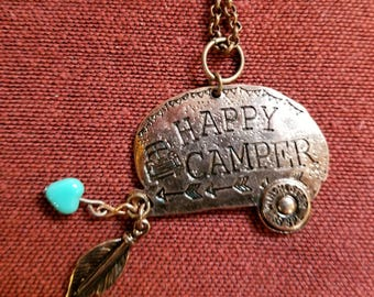 Copper Happy Camper stamped charm with feather and heart.