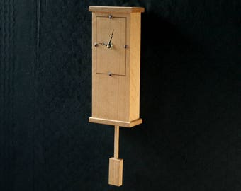 Wooden wall clock, made from oak and walnut with an elegant contemporary design.