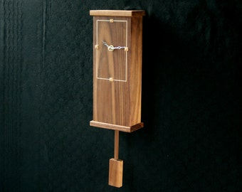 pendulum clocks, wooden wall clock - made from walnut and sycamore. A modern clock for the kitchen or office wall