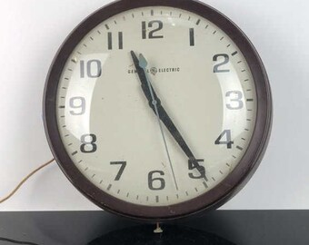 Items similar to Yellow Clock/Vintage GE Yellow Oval Wall Clock