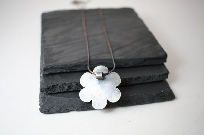 September Birthstone Oxidized sterling silver flower pendant with lab created sapphire faceted stone