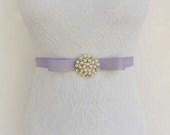 Light purple bow belt. Elastic waist belt. Silver centerpiece decorated with Ivory pearls and rhinestone. Wedding dress belt. Bridal belt.