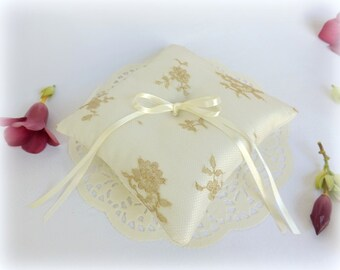Ivory and gold wedding ring pillow. Ivory silk satin ring bearer with gold floral lace.