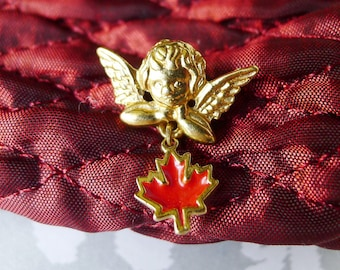 Enamel Canadian Angel Vintage Pin, Red Maple Leaf Dangles Beneath a Putti Angel on this Vintage Enamel Pin Signed Unique Canada