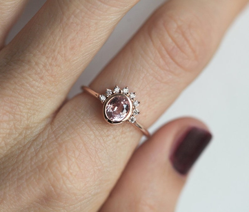 e3d2efaca0346 One Carat Oval Peach Sapphire ring with Diamonds