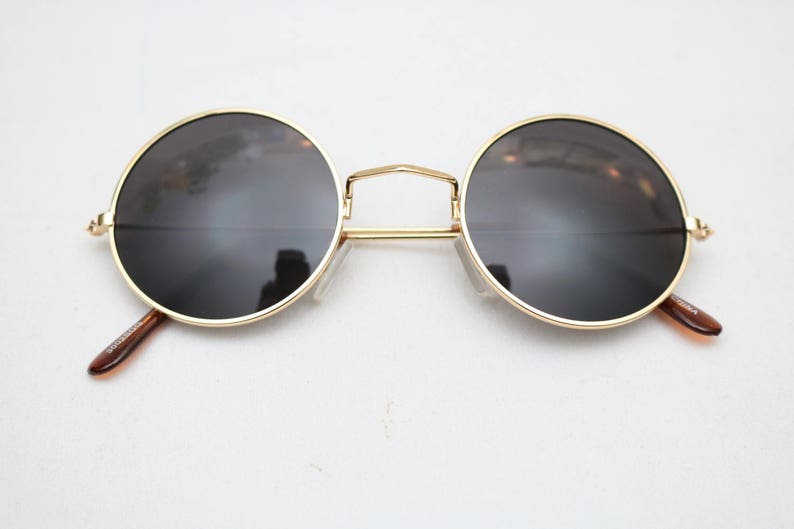 a6f277fd04d Vintage GENESIS Black   Gold JOHN LENNON Round