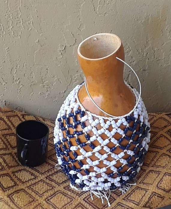 Şèkèrè (medium-small Yoruba-style netted gourd rattle)