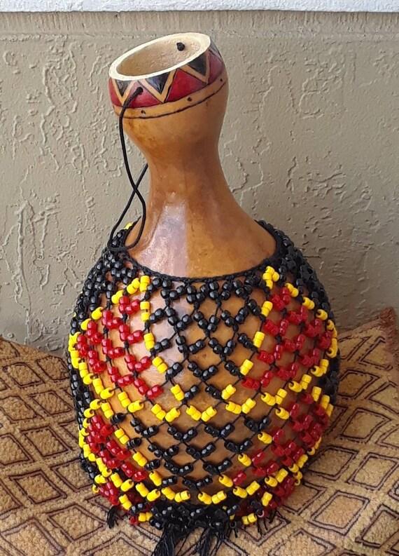 Şèkèrè (medium-large Yoruba-style netted gourd rattle)