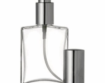 One ounce glass perfume bottle with silver top