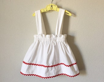 Vintage Toddler Apron / 70s Handmade Ric Rac Trim Baby Girl Suspender Apron Bow Back White Red - 2 3 3T