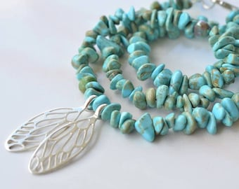 Small Cicada wings on turquoise bead necklace