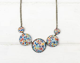 Liberty fabric necklace in multi coloured ''Eve' print.