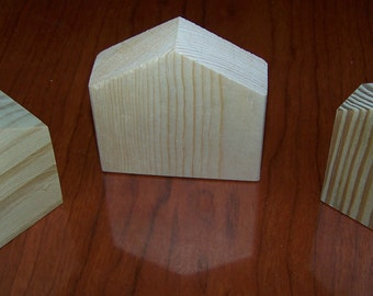 "3 small wooden houses 2 - 2 1/2"" tall - you paint- comes unfinished - great for crafts, kids groups, holidays, etc."