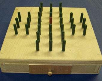 Peg jump game, solitaire, travel game, classic game, board game, like the old classic solitaire game of Hi-Q with drawer storage
